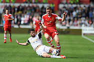 Southampton's Sam Gallagher is tackled by Swansea's Jordi Amat. Barclays Premier league match, Swansea city v Southampton at the Liberty stadium in Swansea, South Wales on Saturday 3rd May 2014.<br /> pic by Andrew Orchard, Andrew Orchard sports photography.