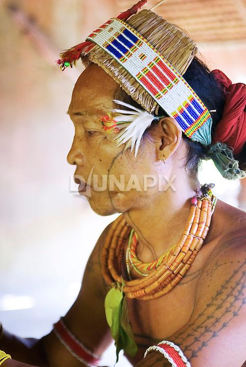 Profile portrait of Sikerei Agoy, shaman of Malagassat village, Siberut, West Sumatra.