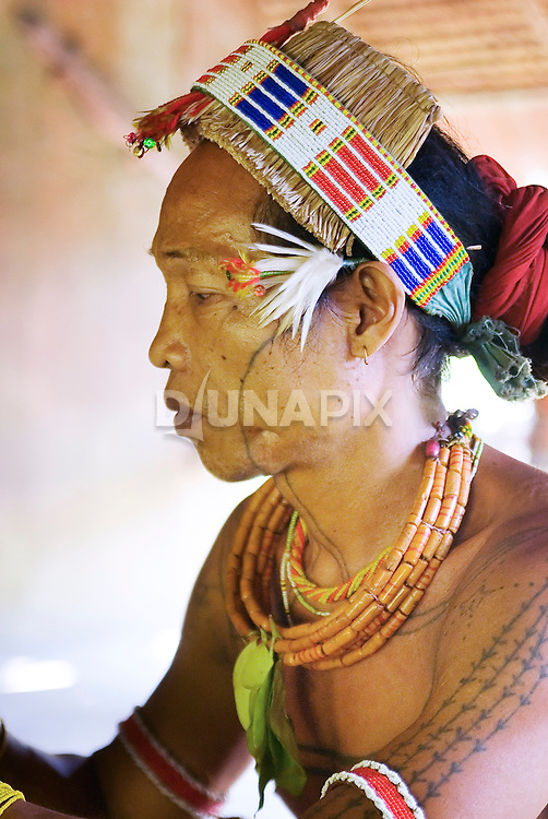 Profile portrait of Sikerei Agoy, shaman of Malagassat village, Siberut, West Sumatra.