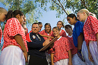 Coach with girls' soccer team (13-17)