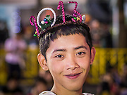 31 DECEMBER 2012 - BANGKOK, THAILAND: A boy wearing a 2013 crown at the New Year's Eve party and countdown in Ratchaprasong Intersection in Bangkok. The traditional Thai New Year is based on the lunar calender and is celebrated in April, but the Gregorian New Year is celebrated throughout the Kingdom, especially in larger cities and tourist centers, like Bangkok, Chiang Mai and Phuket. The Bangkok Countdown 2013 event was called ?Happiness is all Around @ Ratchaprasong.? All of the streets leading to Ratchaprasong Intersection were closed and the malls in the area stayed open throughout the evening.    PHOTO BY JACK KURTZ