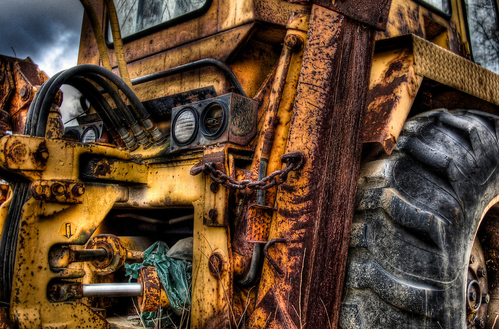 Rear view of a rusty old yellow digger