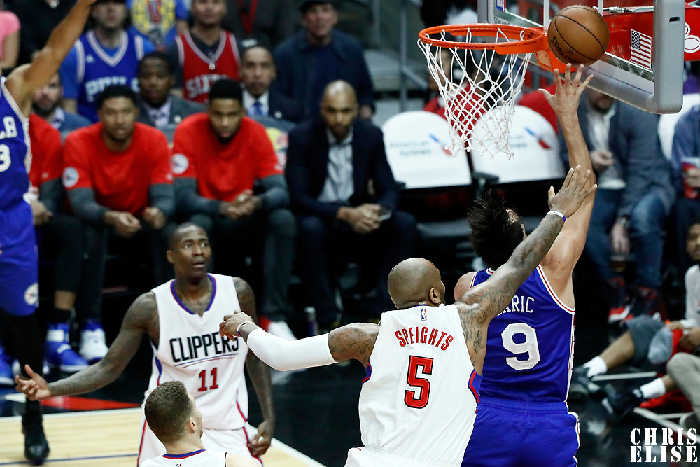 11 March 2017: Philadelphia 76ers forward Dario Saric (9) goes for the layup past LA Clippers center Marreese Speights (5) during the LA Clippers 112-100 victory over the Philadelphia Sixers, at the Staples Center, Los Angeles, California, USA.