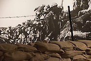 Photos of a museum exhibit depicting a trench from WW I in the Sullivan Museum and History Center.