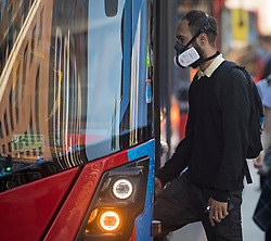 © Licensed to London News Pictures. 15/06/2020. London, UK. A commuter at Victoria Station in London boards a bus, on the day the the easing of lockdown rules means all passengers must wear face masks. Government has introduced further measures to allow non-essential shops and services to reopen under social distancing conditions. Photo credit: Ben Cawthra/LNP
