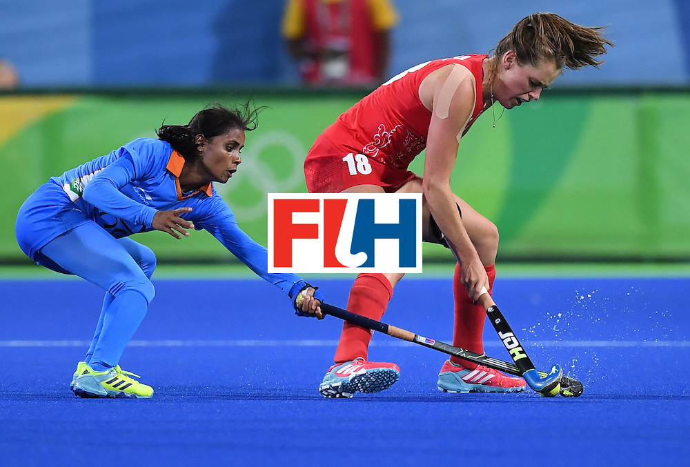 India's Vandana Katariya (L) and Britain's Giselle Ansley vie for the ball during the women's field hockey India vs Britain match of the Rio 2016 Olympics Games at the Olympic Hockey Centre in Rio de Janeiro on August, 8 2016. / AFP / MANAN VATSYAYANA        (Photo credit should read MANAN VATSYAYANA/AFP/Getty Images)