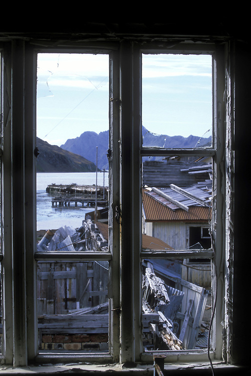 South Georgia Island, Leith Harbour, View through broken window in decaying building in whaling station abandoned in 1960's