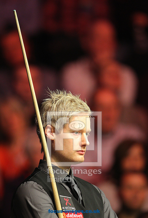 Neil Robertson looks on during the Dafabet Masters final at Alexandra Palace, London<br /> Picture by Paul Terry/Focus Images Ltd +44 7545 642257<br /> 18/01/2015