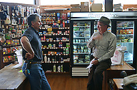 Mike Arcangeli, Arcangeli Grocery Company, trading as Norm's Market, Pescadero, California, USA, left, chatting with a customer, Neil Bromilow. 201305012253<br /> <br /> Copyright Image from Victor Patterson, 54 Dorchester Park, Belfast, UK, BT9 6RJ<br /> <br /> Tel: +44 28 9066 1296<br /> Mob: +44 7802 353836<br /> Voicemail +44 20 8816 7153<br /> Skype: victorpattersonbelfast<br /> Email: victorpatterson@me.com<br /> Email: victorpatterson@ireland.com (back-up)<br /> <br /> IMPORTANT: If you wish to use this image or any other of my images please go to www.victorpatterson.com and click on the Terms & Conditions. Then contact me by email or phone with the reference number(s) of the image(s) concerned.
