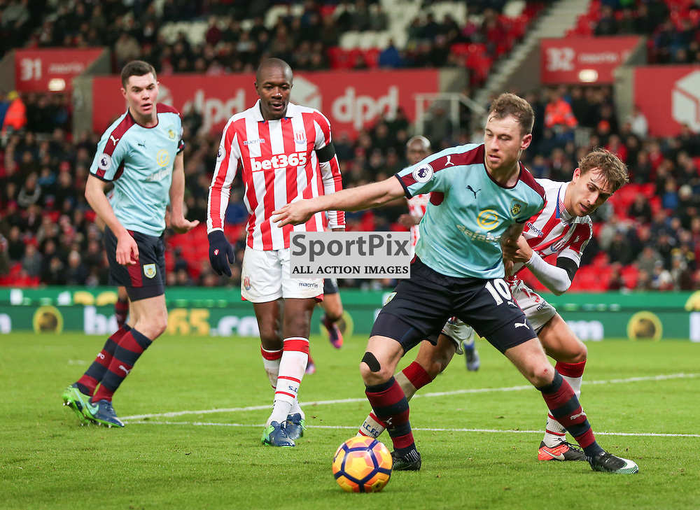STOKE-ON-TRENT, UNITED KINGDOM 03 DECEMBER 2016: Ashley Barnes of Burnely, holds off Marc Munesia in the penalty box during the league game between Stoke City and Burnley at the Britannia Stadium, on December 03, 2016 in Stoke-on-Trent, England. (Photo by Michael Poole)