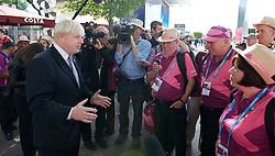 Mayor with London 2012 volunteering heroes<br /> <br /> September 6th 2012 <br /> Peninsular Square, North Greenwich Arena, London, Great Britain <br /> <br />  <br /> The Mayor of London Boris Johnson meets Team London Ambassadors and LOCOG Games Makers to thank them for their service, as they approach their final shifts volunteering for London 2012.<br />  <br /> Since July, 8,000 Ambassadors and 70,000 Games Makers have helped London stage the 2012 Games and welcomed visitors from across the globe<br /> <br /> <br /> Boris Johnson <br /> <br /> <br /> Photograph by Elliott Franks