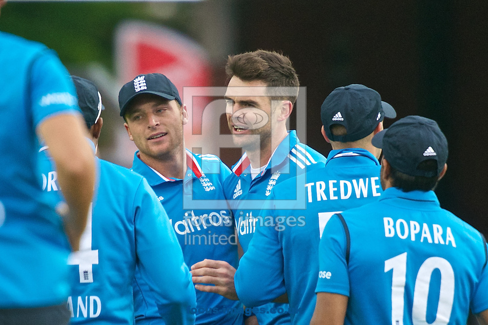 Jos Buttler of England (4th right) celebrates dismissing Tilakaratne Dilshan of Sri Lanka off the bowling of James Anderson (3rd right) of England during the Royal London One Day Series match at Old Trafford Cricket Ground, Stretford<br /> Picture by Ian Wadkins/Focus Images Ltd +44 7877 568959<br /> 28/05/2014