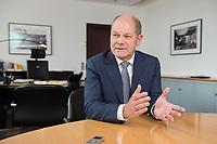 25 JUN 2018, BERLIN/GERMANY:<br /> Olaf Scholz, SPD, Bundesfinanzminister, waehrend einem Interview, in seinem Buero, Bundesministerium der Finanzen<br /> IMAGE: 20180625-02-013<br /> KEYWORDS: Büro