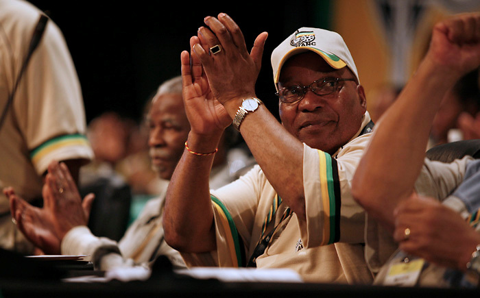 Jacob Zuma, deputy president of the African National Congress, centre, and Thabo Mbeki, South Africa's president, left, applaud at the African National Congress conference in Polokwane, South Africa, on Monday, Dec. 17, 2007. Photographer: Greg  Marinovich/Bloomberg News