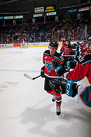 KELOWNA, CANADA - OCTOBER 28: Nolan Foote #29 of the Kelowna Rockets skates past the bench and fist bumps teammates to celebrate a goal against the Prince George Cougars on October 28, 2017 at Prospera Place in Kelowna, British Columbia, Canada.  (Photo by Marissa Baecker/Shoot the Breeze)  *** Local Caption ***