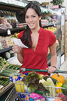 Young woman food shopping in supermarket