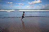 kid enjoy day at the beach.