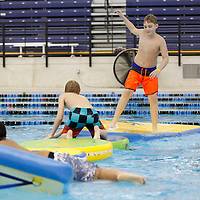 Thomas Wells | BUY at PHOTOS.DJOURNAL.COM<br /> Avery Burrows, 11, of Saltillo tries to walk across the inflatables on Monday at the Tupelo Aquatic Center as most area school are out this week for spring break.