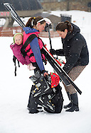 PRICE CHAMBERS / NEWS&amp;GUIDE<br /> While lugging some gear around for her Pole, Pedal, Paddle team, Amanda Thayne gets some help from Shauna Walchenbach as Thayne's daughter hitches a ride on her mother's back Saturday at Jackson Hole Mountain Resort.