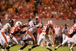 Virginia linebacker Clint Sintim (51) is held in pursuit of North Carolina State running back Jamelle Eugene (29) -- no penalty was called on the play.  The North Carolina State Wolfpack faced the #15 Virginia Cavaliers at Carter Finley Stadium in Raleigh, NC on October 27, 2007.