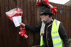 © Licensed to London News Pictures. 11/04/2018. London, UK. A man removes floral tributes from near the house of Richard Osborn-Brooks. Henry Vincent was killed as he burgled the home of 78 year old Richard Osborn-Brooks. Mr Osborn-Brooks was arrested for murder but later released without charge. Friends and family of Henry Vincent have had floral tributes they placed near the scene repeatedly torn down by locals. Photo credit: Peter Macdiarmid/LNP