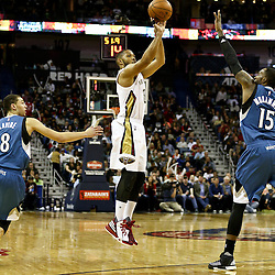 Feb 27, 2016; New Orleans, LA, USA; New Orleans Pelicans guard Eric Gordon (10) shoots over Minnesota Timberwolves forward Shabazz Muhammad (15) and guard Zach LaVine (8) during the second half of a game at  the Smoothie King Center. The Timberwolves defeated the Pelicans 112-110.  Mandatory Credit: Derick E. Hingle-USA TODAY Sports