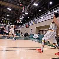 4th year guard Alex Igual (4) of the Regina Cougars lets one go from downtown during the home opener  on November  4 at Centre for Kinesiology, Health and Sport. Credit: /Arthur Images