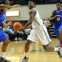 UNCW's Malik Pugh drives against St. Andrews' Jeff Gulley Wednesday December 3, 2014 at Trask Coliseum in Wilmington, N.C. (Jason A. Frizzelle)