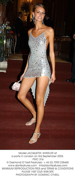 Model JACQUETTA WHEELER at a party in London on 3rd September 2003.<br /> PMC 316