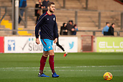 Scunthorpe United defender Charlie Goode warms up for the EFL Sky Bet League 1 match between Scunthorpe United and Luton Town at Glanford Park, Scunthorpe, England on 26 December 2018.