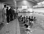 BIM Swimming Lessons For Fishermen..1972..27.05.1972..05.27.1972..27th May 1972..After a recent spate of of accidents at sea where several fishermen had drowned B.I.M.instituted a programme of swimming lessons.Skippers and crews from around the country were encouraged to take part in the hope that safety at sea would improve..Picture of representatives of BIM and the Trawlermens Association encouraging the fishermen taking part in the lesson.