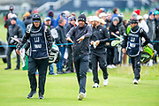 Tony Finau and his caddy walk up the second fairway during the final round of the Alfred Dunhill Links Championship European Tour at St Andrews, West Sands, Scotland on 29 September 2019.