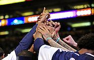 Mar. 10, 2011; Phoenix, AZ, USA; Denver Nuggets teammates react in a huddle against the Phoenix Suns at the US Airways Center. Mandatory Credit: Jennifer Stewart-US PRESSWIRE