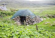Stone roundhouse structure used as croft storage Isle of Barra, Outer Hebrides, Scotland, UK