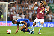Aston Villa midfielder Douglas Luiz (6) pleads his innocence during the Premier League match between Aston Villa and Everton at Villa Park, Birmingham, England on 23 August 2019.