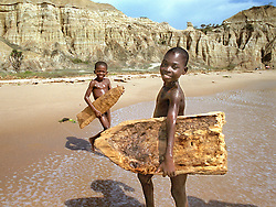 Angolan children attempt to surf on their hand made surf boards which they carved out of driftwood after they watched French foreigners surfing on the beaches outside of the capital of  Luanda in this file photo.  President Jose Eduardo dos Santos, who has led Angola since 1979, said he would not run in presidential elections planned for next year.  Angola's brutal 26 year-civil war has displaced around two million people - about a sixth of the population - and 200 die each day according to United Nations estimates. .(Photo by Ami Vitale)