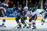 KELOWNA, CANADA - APRIL 25: Sami Moilanen #18 of the Seattle Thunderbirds stick checks Nick Merkley #10 of the Kelowna Rockets after the face off during first period on April 25, 2017 at Prospera Place in Kelowna, British Columbia, Canada.  (Photo by Marissa Baecker/Shoot the Breeze)  *** Local Caption ***