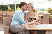 Romantic young couple spending quality time at outdoor restaurant