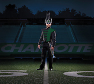 Trumpet player in the University of North Carolina Charlotte marching band on the 50 yard line of the schools football field. Image was created for an advertisement promoting the marching band.