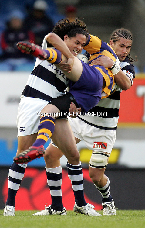 Mike Delany is spear tackled by Tasesa Lavea during the Air New Zealand Cup quarter final rugby match between Auckland and Bay of Plenty at Eden Park, Auckland, on Saturday 7 October 2006. Auckland won the match 46-14. Photo: Andrew Cornaga/PHOTOSPORT<br /><br /><br />071006
