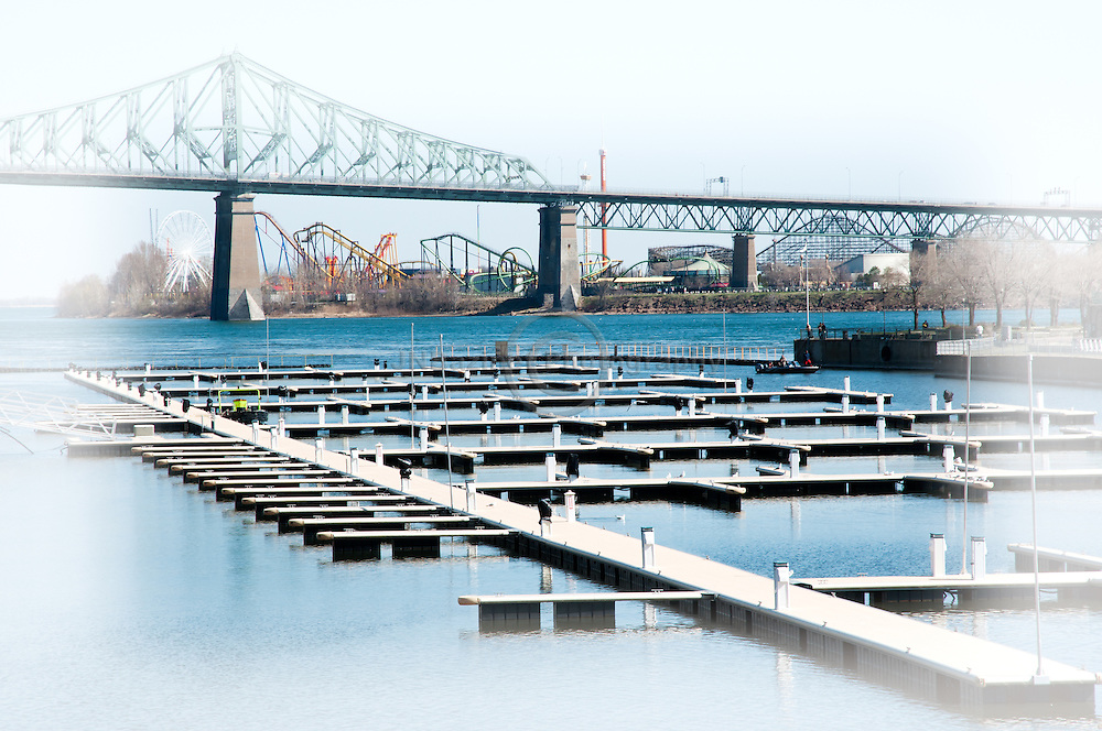 La Ronde amusement park on ile Sainte-Helene is framed by the marina in the foreground and Jacques Cartier bridge overhead.(Quebec, Canada)