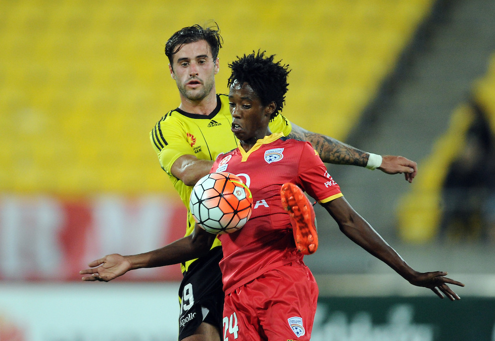 Adelaide United's Bruce Kamau chests the ball in front of Phoenix's Thomas Doyle in the A-League football match at Westpac Stadium, Wellington, New Zealand, Saturday, March 05, 2016. Credit:SNPA / Ross Setford