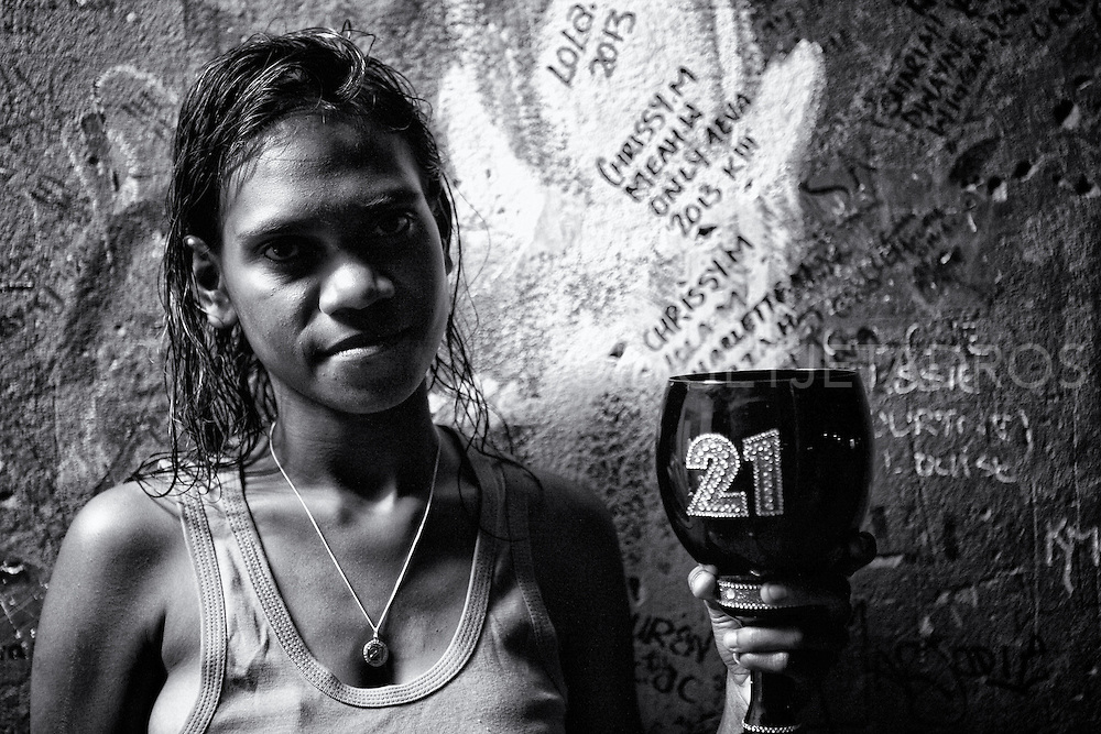 """Chrissy holding a birthday cup which has the number 21 on it. Chrissy turned 21 years old, her mum Elaine Wiggan said to me; """"She is a loving mum and does not drink, she stays home and looks after her two kids."""" Broome, Western Australia.©Ingetje Tadros/Diimex"""