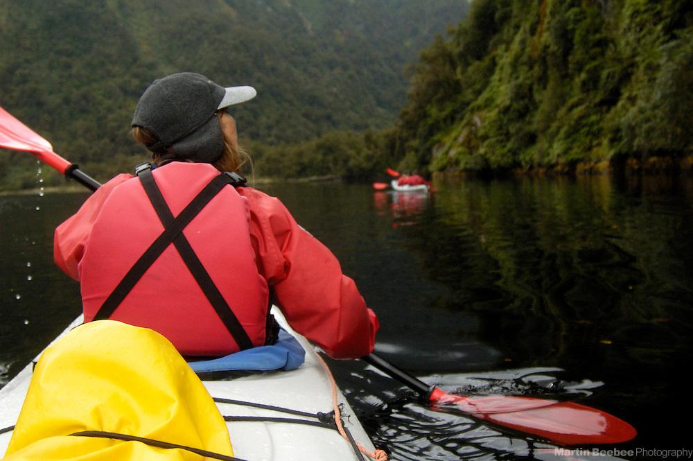 Kayakers on Doubtful Sound, Fiordland National Park, New Zealand