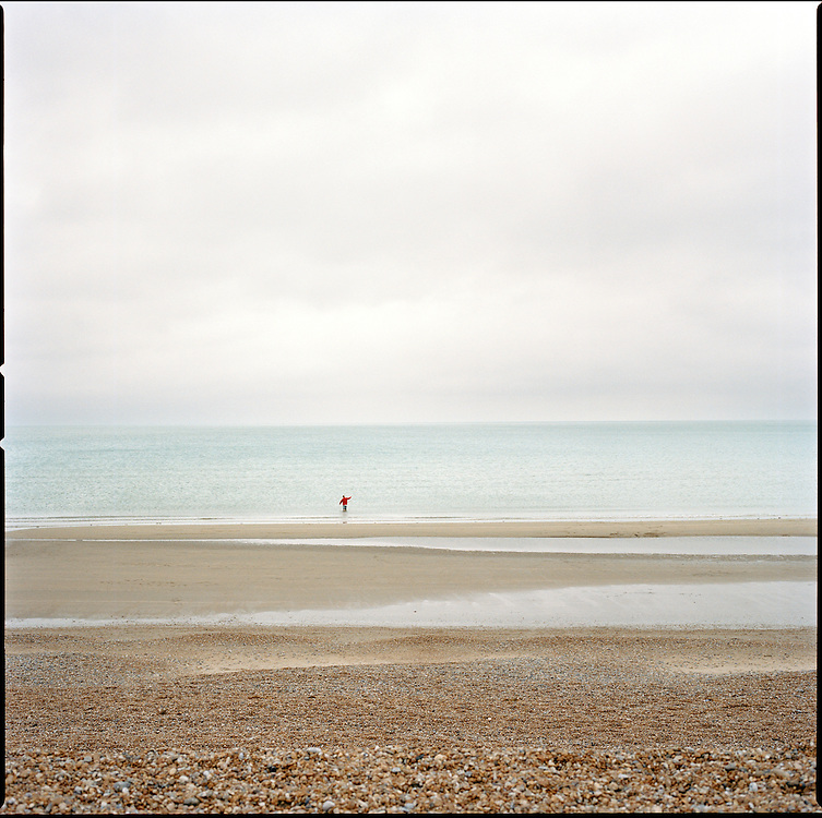 A man fishes in the sea near the Camber Sands Beach and Holiday Park