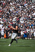 Oakland Raiders quarterback Derek Carr (4) looks for an open receiver against the Atlanta Falcons at Oakland Coliseum in Oakland, Calif., on September 18, 2016. (Stan Olszewski/Special to S.F. Examiner)