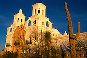 Mission San Xavier, view from Southeast with mission, saguaro cactus and yucca in front, Tucson, Arizona. ..Subject photograph(s) are copyright Edward McCain. All rights are reserved except those specifically granted by Edward McCain in writing prior to publication...McCain Photography.211 S 4th Avenue.Tucson, AZ 85701-2103.(520) 623-1998.mobile: (520) 990-0999.fax: (520) 623-1190.http://www.mccainphoto.com.edward@mccainphoto.com.