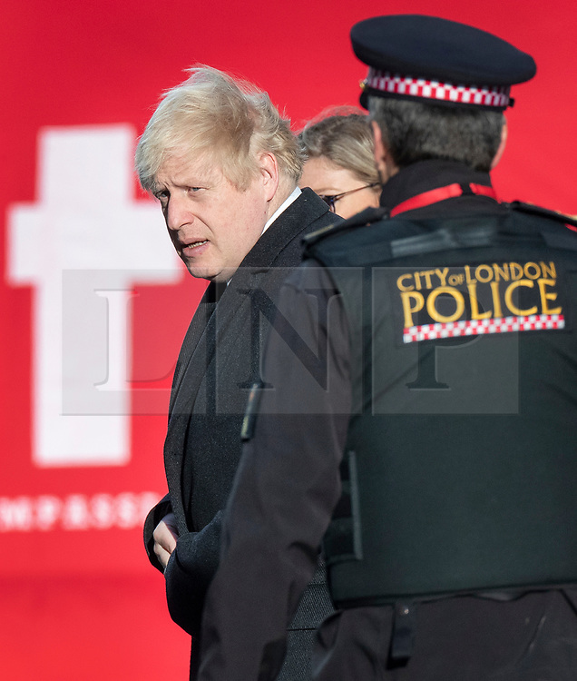 © Licensed to London News Pictures. 30/11/2019. London, UK. Prime Minister Boris Johnson visits the scene of the London Bridge terrorist attack. Two people were killed and three injured after the attacker, named by police as 28-year-old Usman Khan stabbed a man and a woman to death on London Bridge. Photo credit: Peter Macdiarmid/LNP