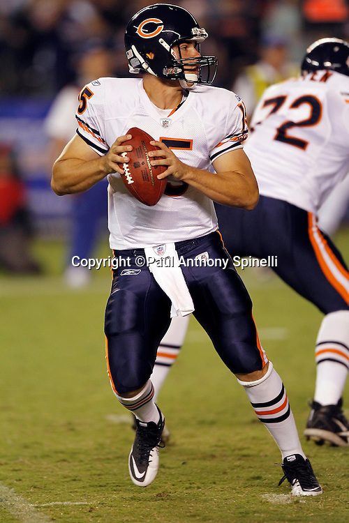 Chicago Bears rookie quarterback Dan LeFevour (15) drops back to pass during a NFL week 1 preseason football game against the San Diego Chargers, Saturday, August 14, 2010 in San Diego, California. The Chargers won the game 25-10. (©Paul Anthony Spinelli)
