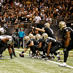 Nov 24, 2014; New Orleans, LA, USA; New Orleans Saints quarterback Drew Brees (9) calls a play at the line against the Baltimore Ravens during the first quarter of a game at the Mercedes-Benz Superdome. Mandatory Credit: Derick E. Hingle-USA TODAY Sports